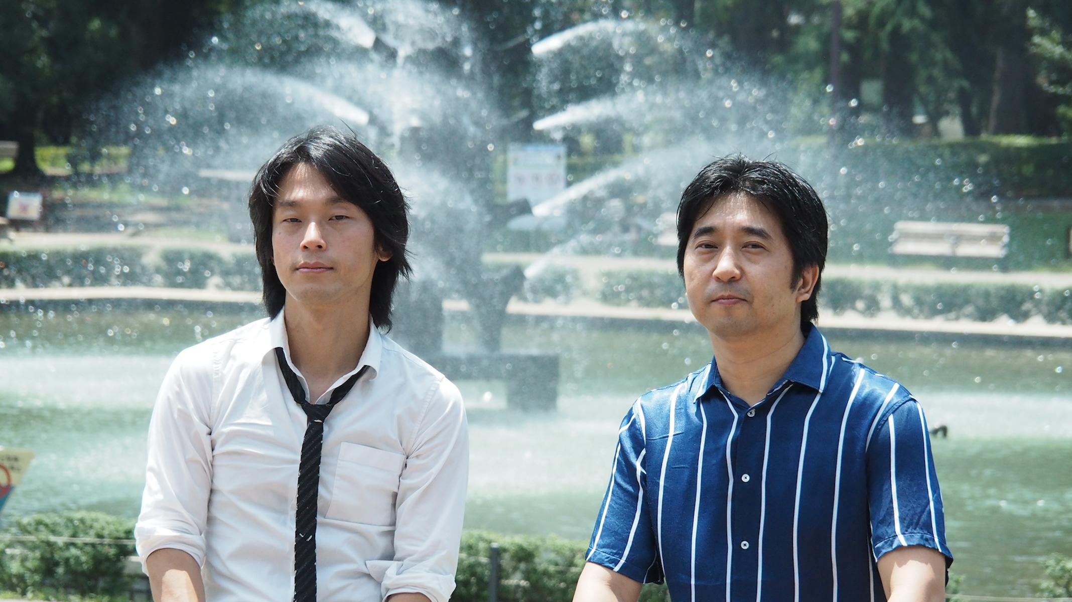 プロジェクトマネージャーの洪泰和と開発リーダーの四家和彦